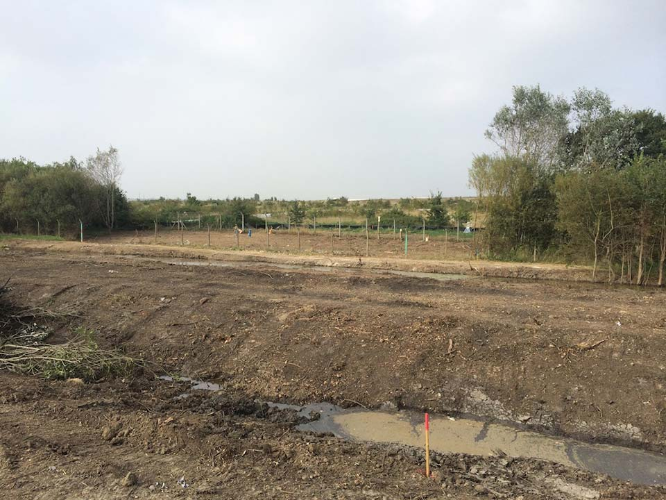 View across cleared bund site with receptor site in distance